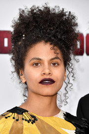 Zazie Beetz continued the edgy vibe with a dark lip.