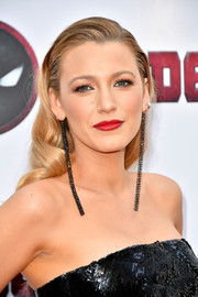 Blake Lively spiced up her look with an ultra-long pair of black diamond earrings by Ofira.