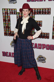 Molly Ringwald layered a black sweater over a white pussybow blouse for her 'Deadpool' fan event red carpet look.