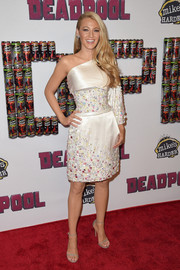 Blake Lively looked playfully glam at the 'Deadpool' fan event in a white Chanel Couture one-shoulder dress embellished with multicolored stones.