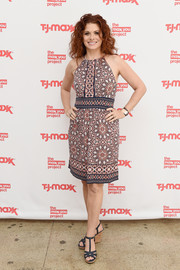 Debra Messing paired her dress with blue T-strap wedges.
