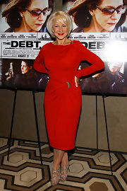Helen Mirren was red hot at the premiere of 'The Debt' in a Michael Kors dress. The ruched detailing and brooch embellishments complemented the demure ensemble.