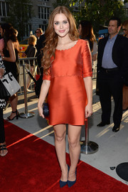 Holland Roden donned a red Philosophy by Natalie Ratabesi cocktail dress with scallop detailing for the screening of 'Deliver Us from Evil.'
