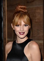 Bella rocked a twisted top knot bun that highlighted her bold bangs.