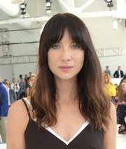 Caitriona Balfe attended the Delpozo fashion show wearing barely-there waves and rounded bangs.