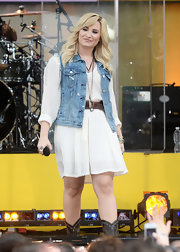 Demi wore a denim vest over her white day dress for a cool and casual touch.