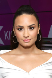 Demi Lovato accessorized with a pair of classic gold hoops.
