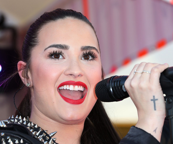 Demi Lovato False Eyelashes [lip,facial expression,microphone,singer,singing,nose,beauty,eyebrow,music artist,mouth,arrivals,demi lovato,california,los angeles,the grove,topshop,topman,topman british street party to celebrate the la opening moment,la grand opening]