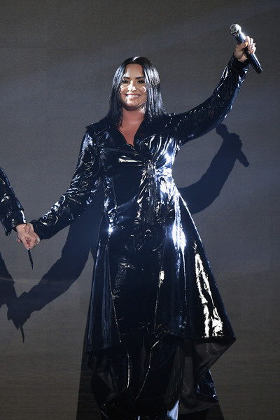 Demi Lovato Leather Coat [outerwear,fashion,latex clothing,performance,costume,action figure,latex,cosplay,fictional character,demi lovato,billboard music awards,las vegas,nevada,mgm grand garden arena,show]