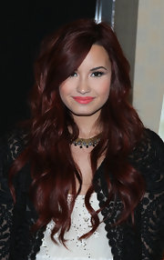 Demi Lovato wore her long burgundy tresses in tousled layers at a signing of her 'Seventeen' magazine cover.
