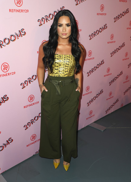 Demi Lovato Tube Top [photo,clothing,fashion,hairstyle,yellow,long hair,waist,fashion model,joint,shoulder,fashion design,demi lovato,caption,los angeles,refinery29 29rooms,29rooms,row dtla,refinery29,getty images,turn it into art opening night party]