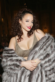 Dascha Polanco rocked a tan bra top and patterned fur coat combo at the Dennis Basso fashion show.