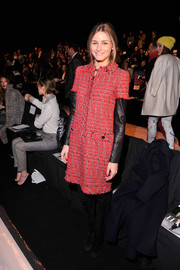 Olivia Palermo chose a stylish red tweed dress by Carolina Herrera for the Dennis Basso fashion show.