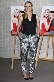 Printed pants are hard to pull off, but Diane Kruger worked these floral print pants.