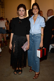 Leandra Medine rocked a pair of wide-leg jeans with her button-down.