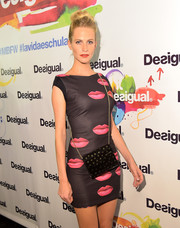 Poppy Delevingne went for a fun lip-printed mini dress at the Desigual Spring/Summer 2015 show.