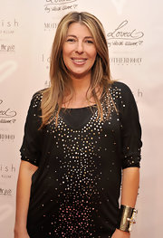 Nina Garcia accessorized with a chunky gold cuff bracelet at the Destination Maternity celebration of Fashion's Night Out.