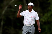 Tiger Woods kept his look more minimal with this white polo with simple red stripes.