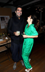 Marisa Tomei laughed it up in white pumps. She paired the heels with a kelly green jumpsuit.