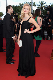 Pixie Lott exuded classic glamour in a black sweetheart-neckline gown by Dsquared2 at the 'Dheepan' premiere in Cannes.