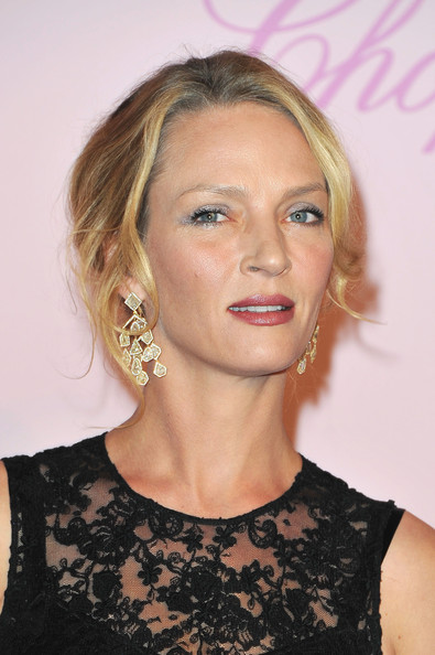 Uma Thurman continued to sparkle during her Cannes Film Festival rounds, wearing these dazzling chandelier earrings to the Diamonds Are a Girl's Best Friend fete.