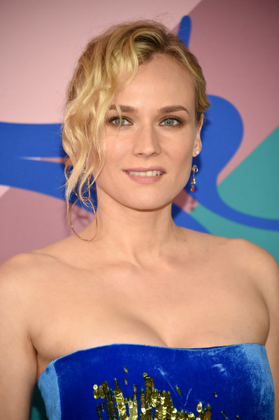 Diane Kruger Messy Updo [hair,hairstyle,blond,eyebrow,beauty,shoulder,electric blue,long hair,premiere,smile,arrivals,diane kruger,hammerstein ballroom,new york city,cfda fashion awards]