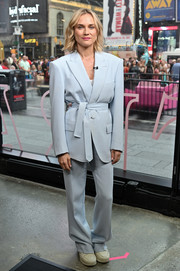 Diane Kruger visited 'Extra' wearing a bold-shouldered baby-blue pantsuit by Prabal Gurung.
