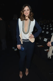 Katharine McPhee chose a dressier pair of navy slacks with an embellished waist at the DVF runway show.