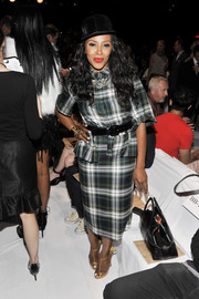 June Ambrose's plaid shirtdress at the Diane Von Furstenberg fashion show looked a bit unflattering to her figure.