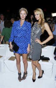 Nicky Hilton hid her figure under a loose blue print dress when she attended the Diane Von Furstenberg fashion show.
