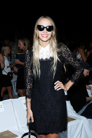 Harley Viera-Newton attended the Diane Von Furstenberg fashion show wearing a cool pair of cateye sunnies.