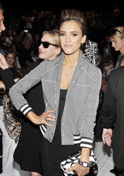Jessica Alba smartened up her look with a black-and-white striped jacket when she attended the Diane Von Furstenberg fashion show.