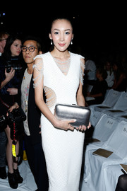 Lily Kwong's metallic silver clutch added major shine to her look during the Diane Von Furstenberg fashion show.