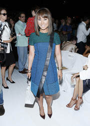 Alina Cho looked chic and modern in a tricolor leather-panel dress at the Diane Von Furstenberg fashion show.