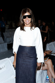 Carine Roitfeld exuded a youthful vibe in a white crop top and a denim skirt at the Diane Von Furstenberg fashion show.