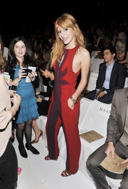 Bella Thorne looked stylish and fun in a red and purple jumpsuit with a keyhole neckline at the Diane Von Furstenberg fashion show.