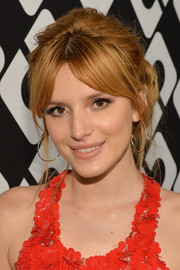 Bella Thorne was retro-glam with this messy center-parted updo at the Journey of a Dress exhibition opening.