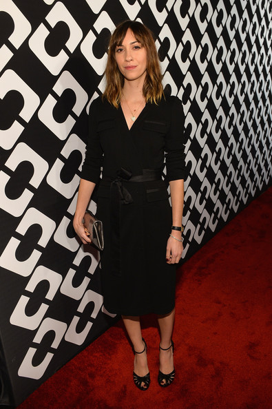 Gia Coppola looked timeless in a black Diane von Furstenberg wrap dress during the Journey of a Dress exhibition opening.