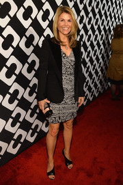 Lori Loughlin kept it basic with a black blazer layered over a print dress during the Journey of a Dress exhibition opening.