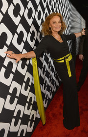 Diane von Furstenberg donned a kimono-inspired black and yellow wrap dress for the Journey of a Dress exhibition opening.