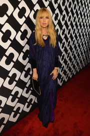 Rachel Zoe paid tribute to DVF by wearing this vintage purple number to the Journey of a Dress exhibition opening.