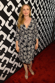 Julie Delpy kept it classic in a black-and-white wrap dress at the Journey of a Dress exhibition opening.