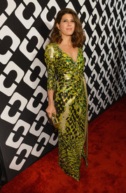 Marisa Tomei chose a vintage Diane von Furstenberg wrap dress in a vibrant print for the Journey of a Dress exhibition opening.