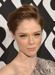 Coco Rocha sported a stylish gelled side-parted 'do at the Journey of a Dress exhibition opening.