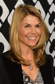 Lori Loughlin attended the Journey of a Dress exhibition opening wearing her hair in face-framing layers.