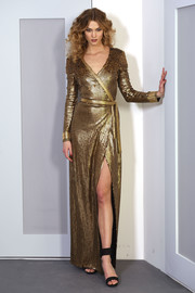Karlie Kloss looked fierce in a gold chainmail wrap dress at the Diane von Furstenberg presentation.