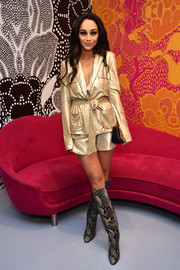 Cara Santana attended the Diane von Furstenberg presentation wearing a gold lame short suit from the brand.