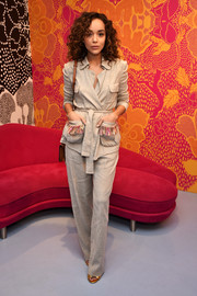 Ashley Madekwe was safari-chic in a gray DVF pantsuit with fringed pockets during the brand's presentation.