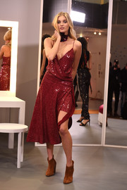 Elsa Hosk glittered in a sequined red wrap dress at the Diane von Furstenberg presentation.