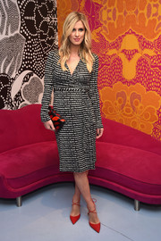 Nicky Hilton tied her stylish look together with a DVF lip-print clutch.
